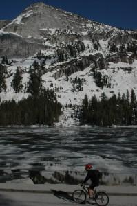 Bob Leung rides past a frozen Tenaya Lake.